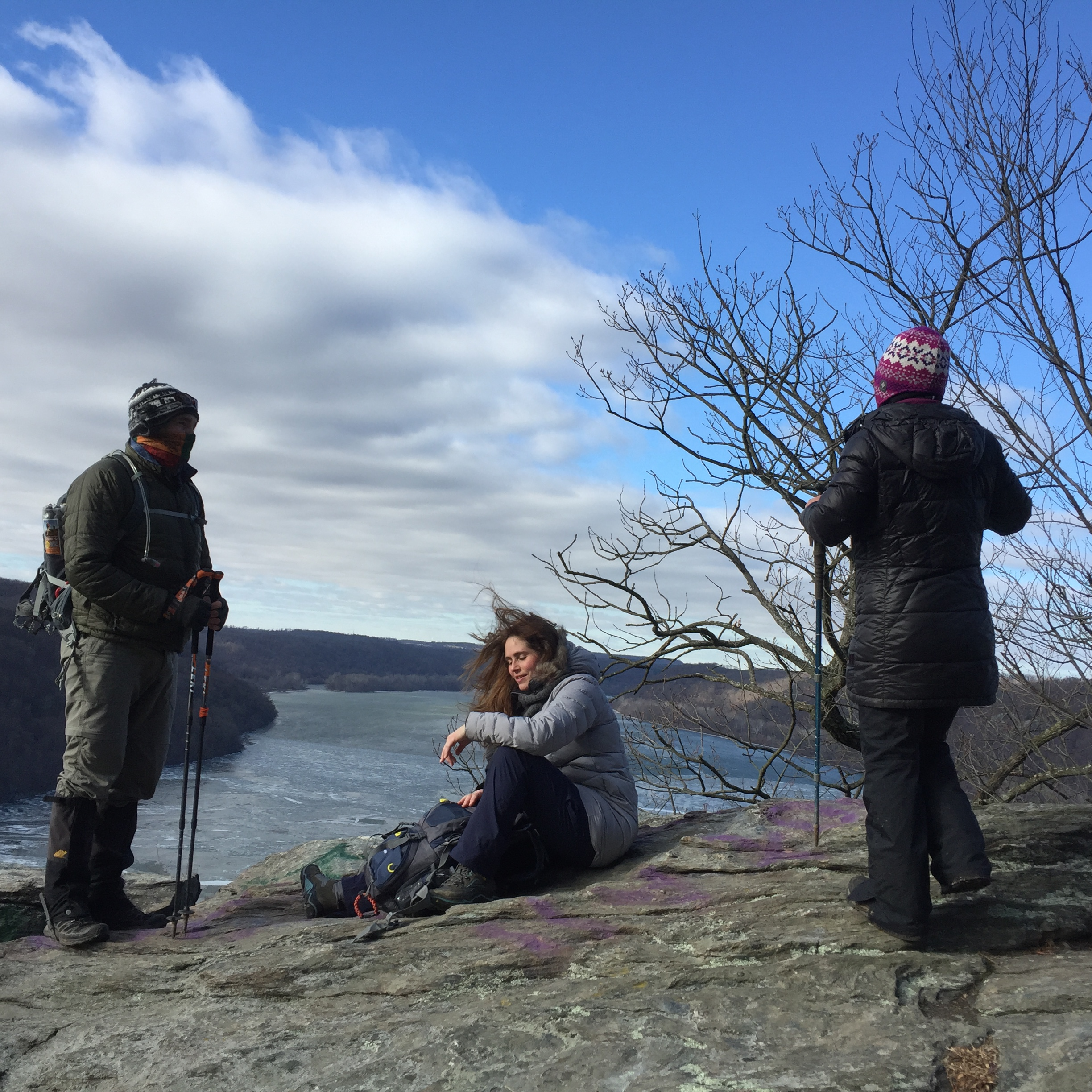 a group of hikers take a break at a vista