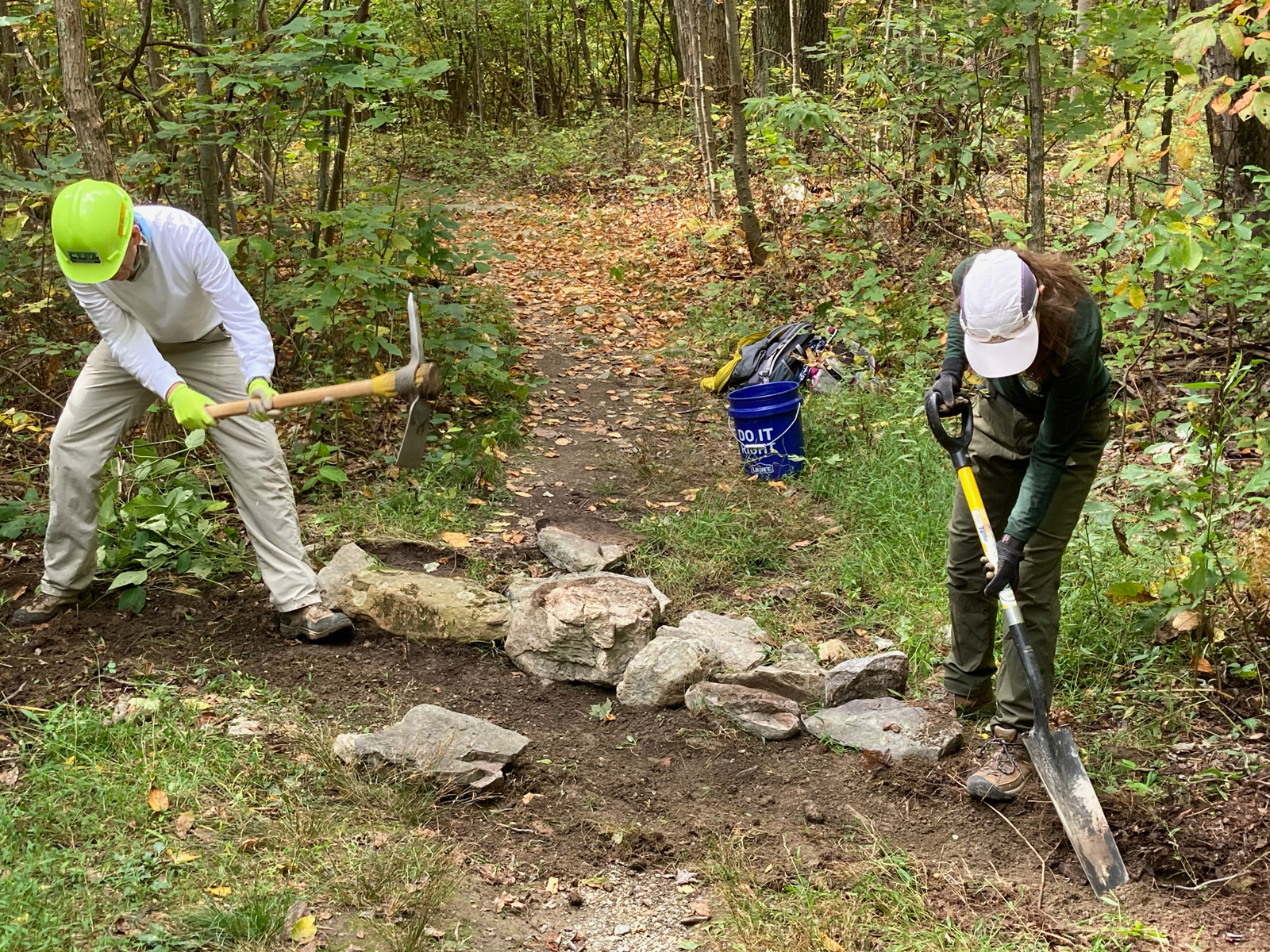 two trail workers working