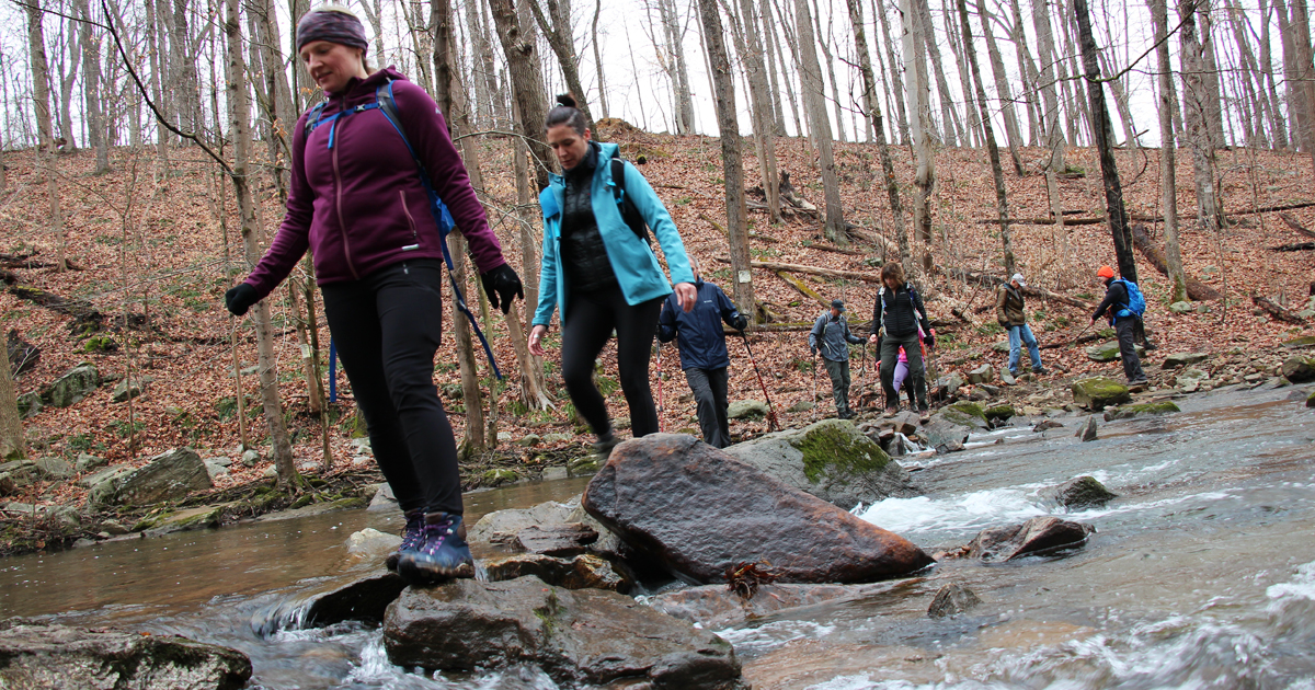 Hikers-cross-large-stream